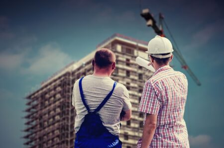 Houston construction management professional talking to subcontractor for commercial construction building